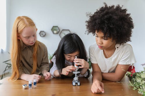 Kids using a microscope
